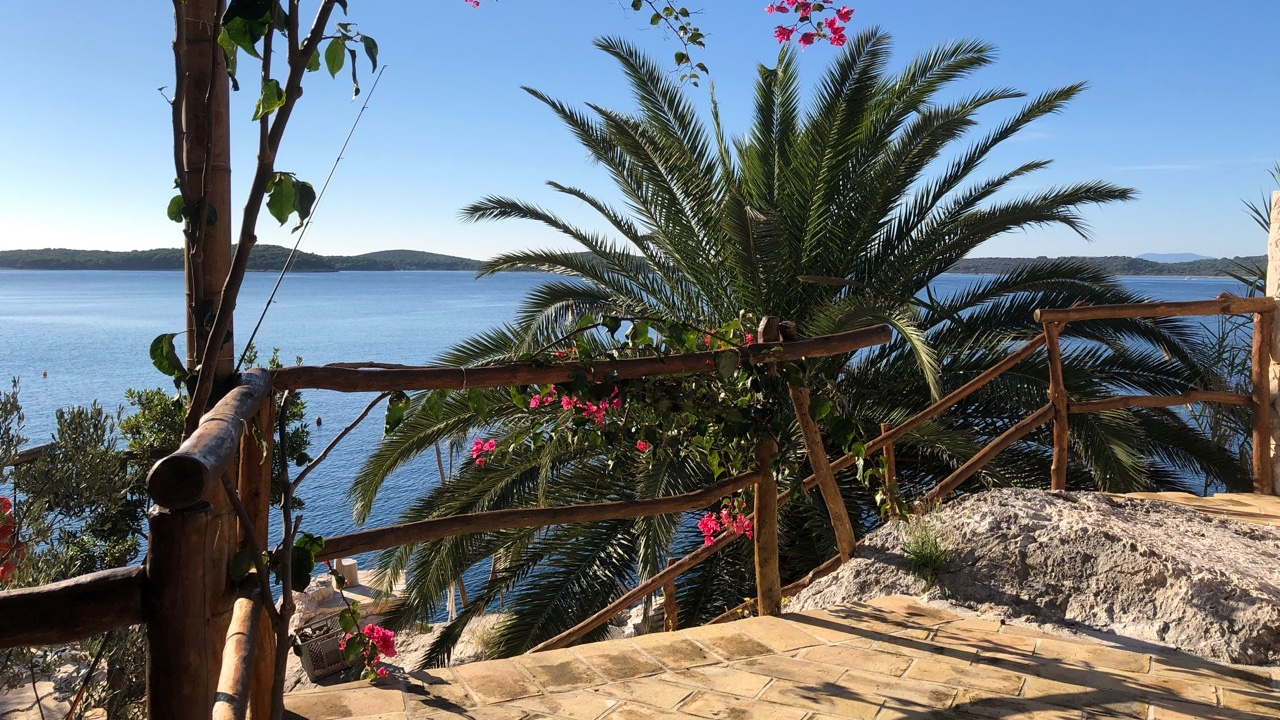 A spectacular detached house in Hvar town for sale with sea views and direct sea access from garden.