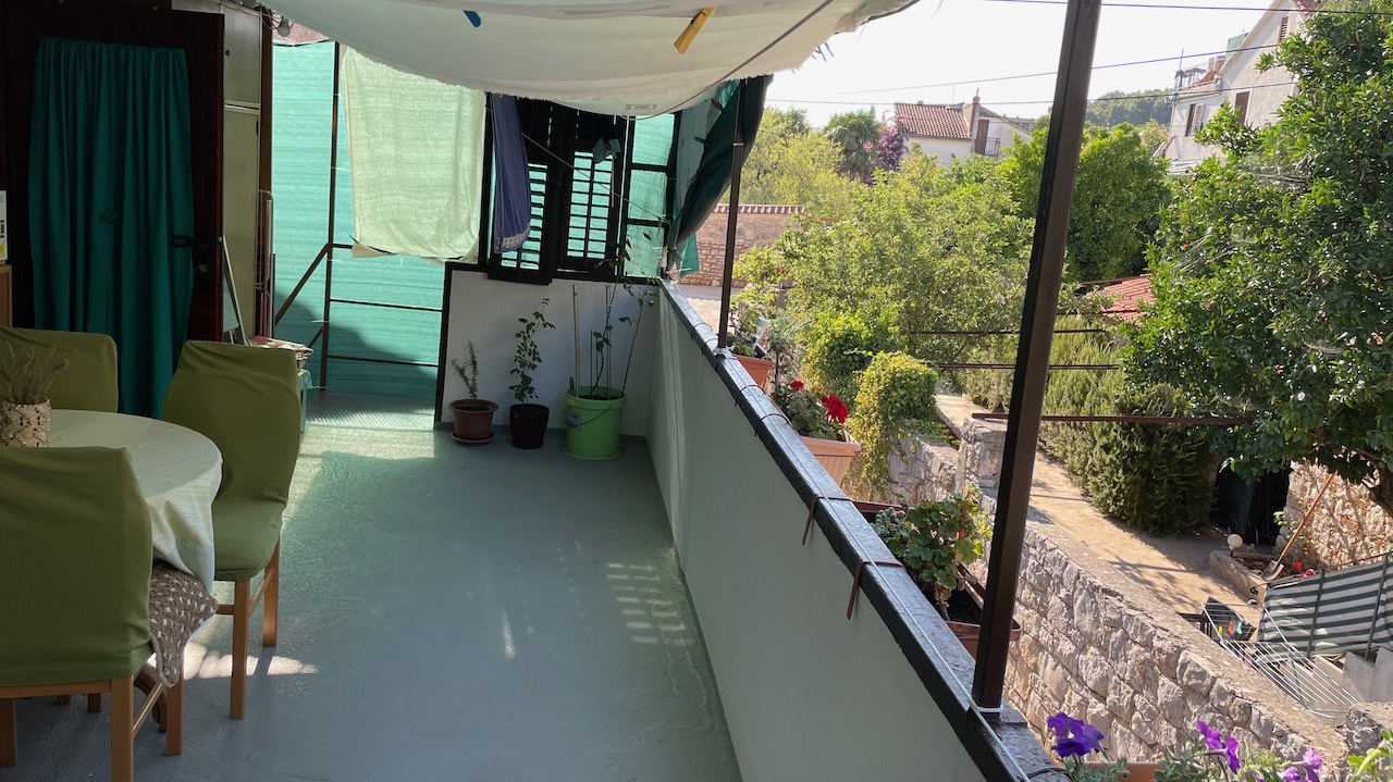 A duplex apartment in Stari Grad with a terrace arranged over the ground and first floor.